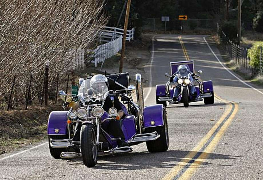 In this Jan. 10, 2010  photo, Scottie Sisemore, left, and David Sisemore, right, ride their three-wheeled motorcycles during a club ride in San Diego. Dial is among a growing group of aging motorcyclists taking up trikes; three-wheeled motorcycles that provide stability and nearly all the comforts of a car while still allowing riders to feel the wind in their face. Photo: Denis Poroy, AP