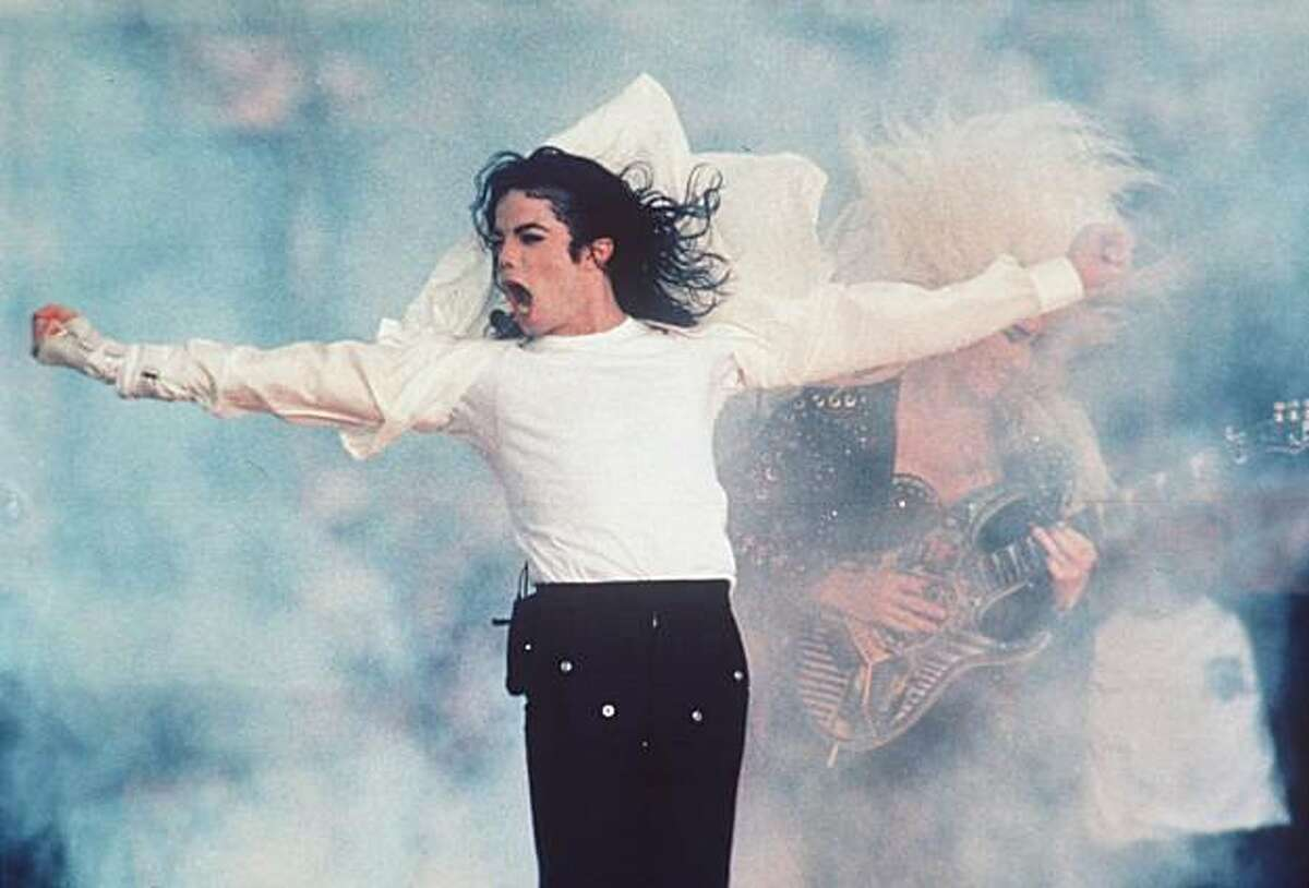 FILE--Michael Jackson performs at Super Bowl XVII in Pasadena on Feb. 1, 1993. At age 30, the Super Bowl turns a significant milestone this year, firmly entrenched in the national psyche, an event so enormous that the country seems to stop at the end of each January to watch this slice of Americana take place. (AP Photo/file)
