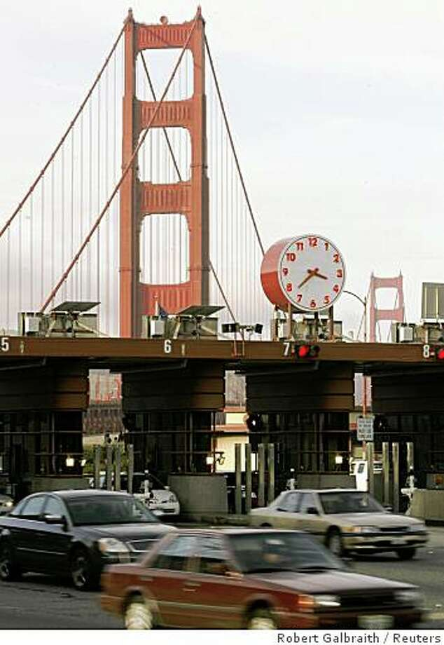 Vehicular traffic passes through the toll gates on the Golden Gate Bridge. Bridge directors approved a $1 toll increase that goes into effect Sept. 1 which will raise the cost of crossing the landmark bridge to $5 for FasTrak users and $6 for cash payers. Photo: Robert Galbraith, Reuters