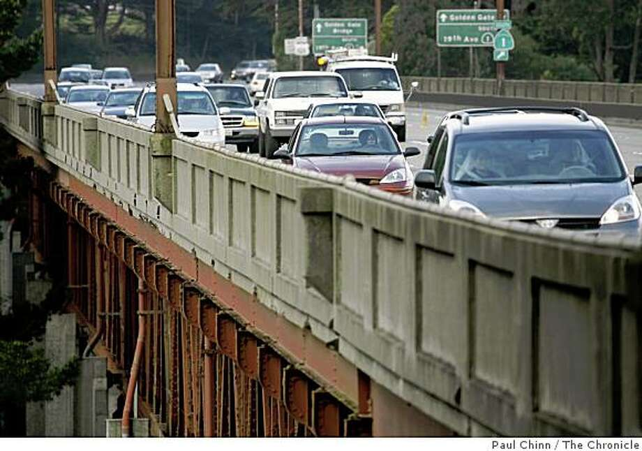 Morning commuters on Doyle Drive, the elevated portion of Highway 101 stretching from the Golden Gate Bridge to Lombard Street, in San Francisco, Calif. on March 15, 2006. Photo: Paul Chinn, The Chronicle