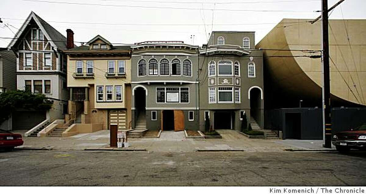 Congregation Beth Shalom's new Synagogue, right, finds its place among traditional homes on 14th Avenue near Clement Street in San Francisco, Calif. Photographed on Friday, Aug. 8, 2008.