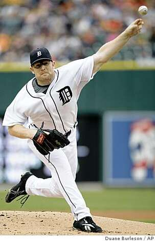 Detroit Tigers starter Nate Robertson pitches against the Oakland Athletics in the first inning of a game Sunday, Aug. 10, 2008 in Detroit. Photo: Duane Burleson, AP