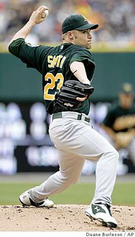 Oakland Athletics starter Greg Smith pitches against the Tigers in the first inning of a game Sunday, Aug. 10, 2008 in Detroit. Photo: Duane Burleson, AP