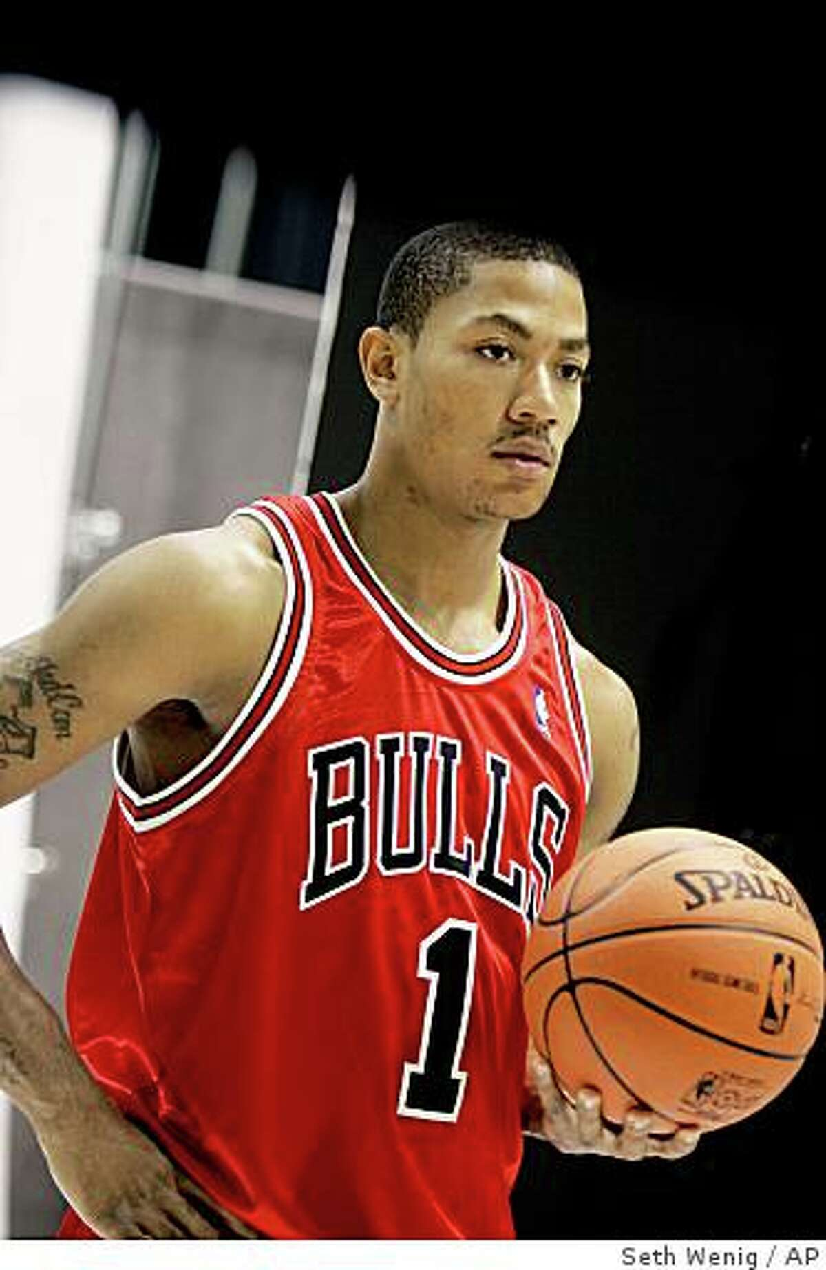 Chicago Bulls' Derrick Rose poses for a photo during the NBA Rookie Photo Shoot in Tarrytown, N.Y., Tuesday July 29, 2008. More than thirty of the NBA's newest players had their photos taken for trading cards during the event. (AP Photo/Seth Wenig)