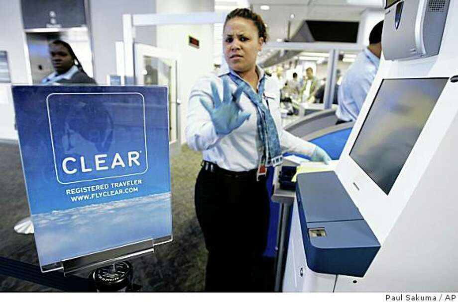 "A Clear worker gestures at San Francisco International Airport in San Francisco, Tuesday, Aug. 5, 2008. A laptop containing the sensitive personal information of 33,000 applicants to an airport security prescreening program Clear, has been reported stolen from San Francisco International Airport. The TSA has suspended new enrollments in the program, known as Clear, which allows passengers to pay to use special ""fast lanes"" to avoid long lines at airport security checkpoints.  (AP Photo/Paul Sakuma) Photo: Paul Sakuma, AP"