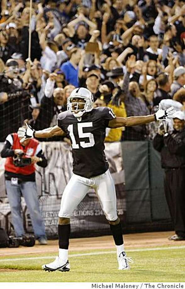 Raiders Johnnie Lee Higgins celebrates his punt return touchdown in the 2nd quarter.The Oakland Raiders host the San Francisco 49ers in a NFL preseason game at McAfee Coliseum in Oakland, Calif., on August 8, 2008. Photo: Michael Maloney, The Chronicle