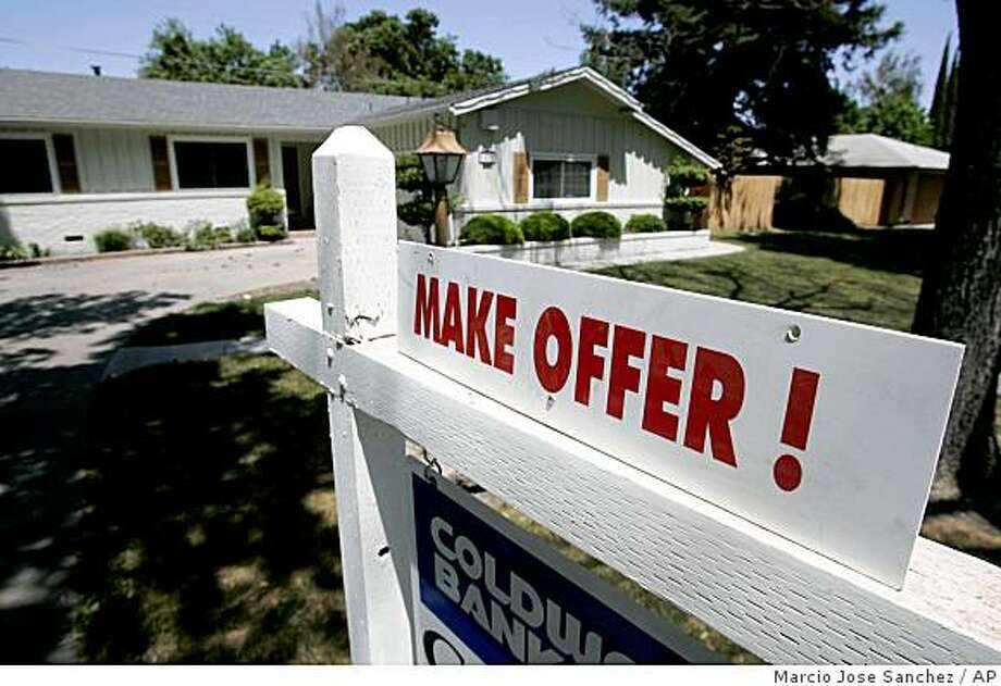 A home is advertised for sale in Stockton in May 2008. Photo: Marcio Jose Sanchez, AP