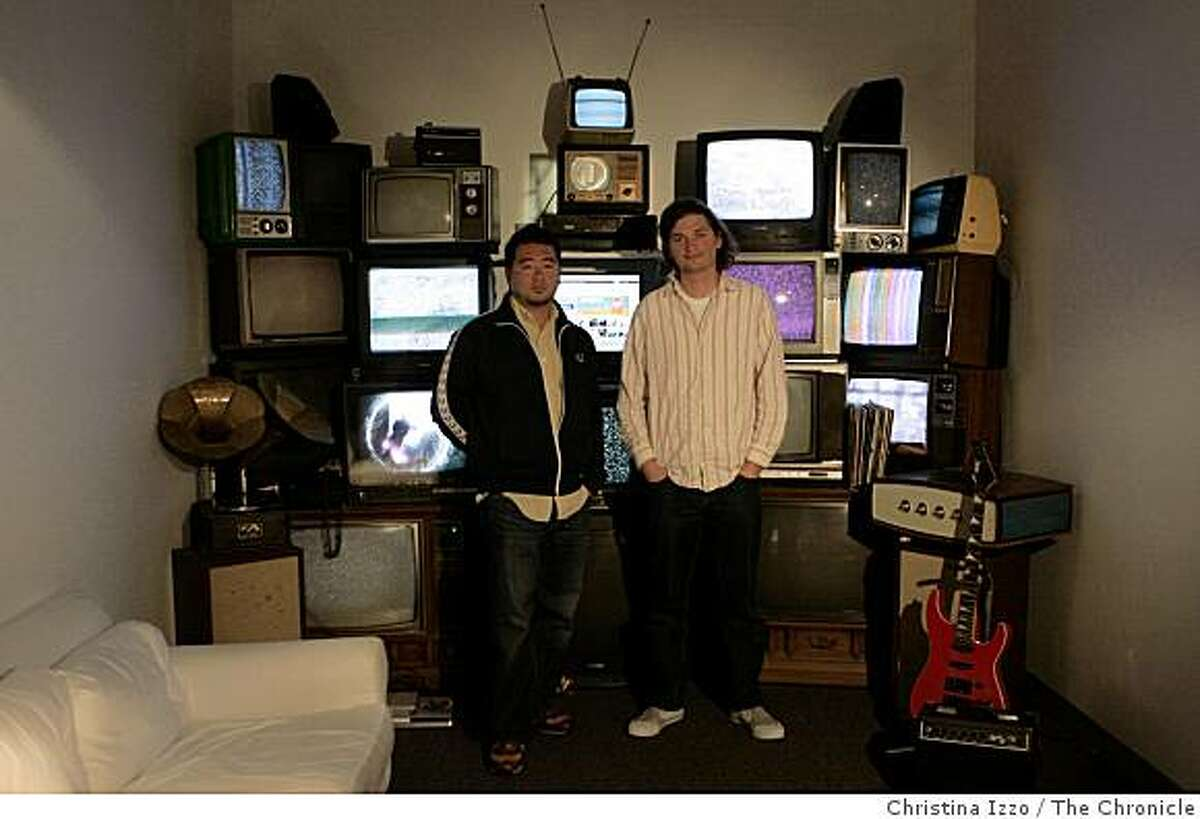Steve Jang, left, CMO and head of business development and Dalton Caldwell, founder and CEO of Imeem stand in the lobby of their office on Monday, August 4,2008, San Francisco, Calif.
