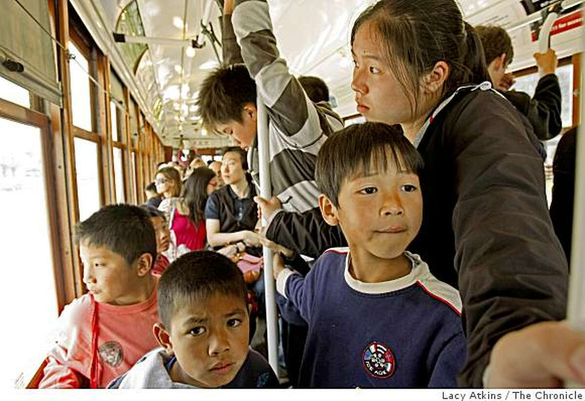 Linda Liu escorts students from the Noriega Daycare on the San Francisco streetcar to Pier 39, Monday Aug. 04, 2008 in San Francisco, Calif.