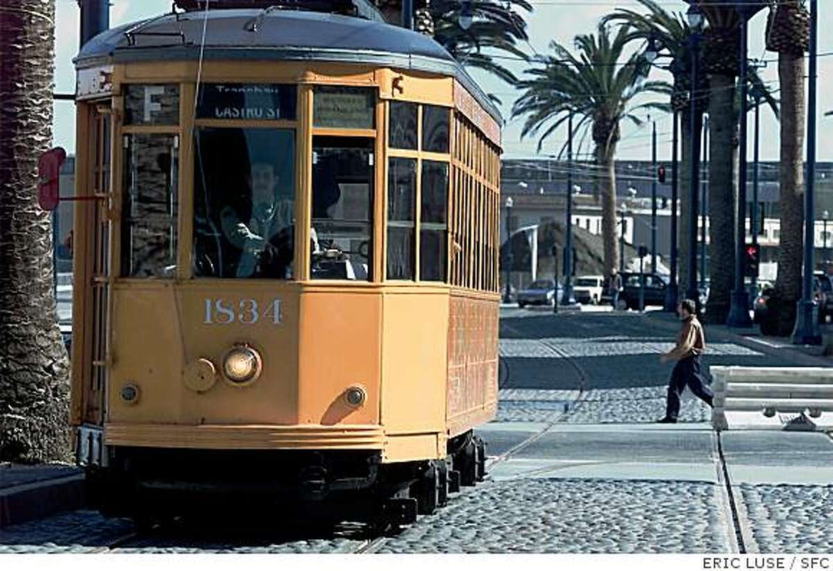 A Muni Milan streetcar goes for a test run along the Embarcadero in February of 2000.