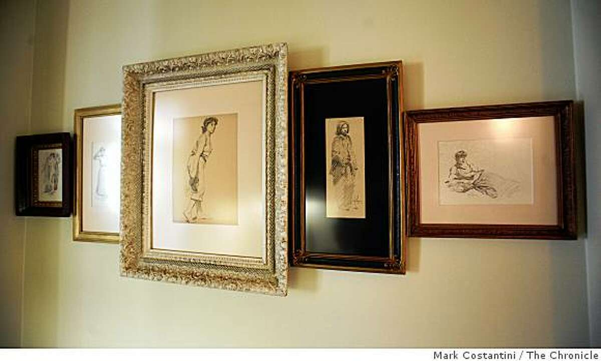 """These figures by John Whitworth Robson are arranged in a """"Paris hang."""" Grouping art for a powerful presentation is one feature at this year's Sunset Idea House in Menlo Park, Calif. on Tuesday, July 1, 2008 Photo by Mark Costantini / The Chronicle."""