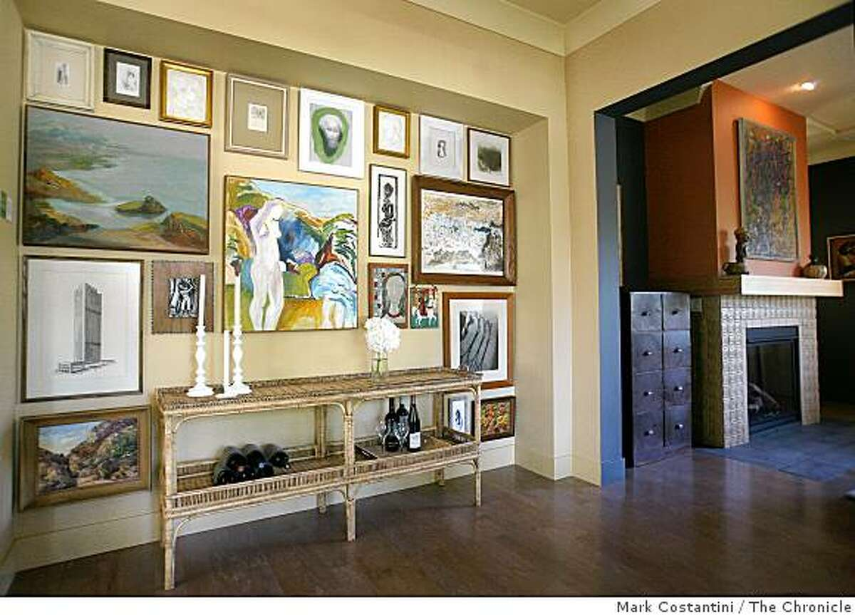 """A """"mosaic hang"""" mixes art of different mediums and sizes for a powerful presentation at this year's Sunset Idea House in Menlo Park, Calif. on Tuesday, July 1, 2008 Photo by Mark Costantini / The Chronicle."""