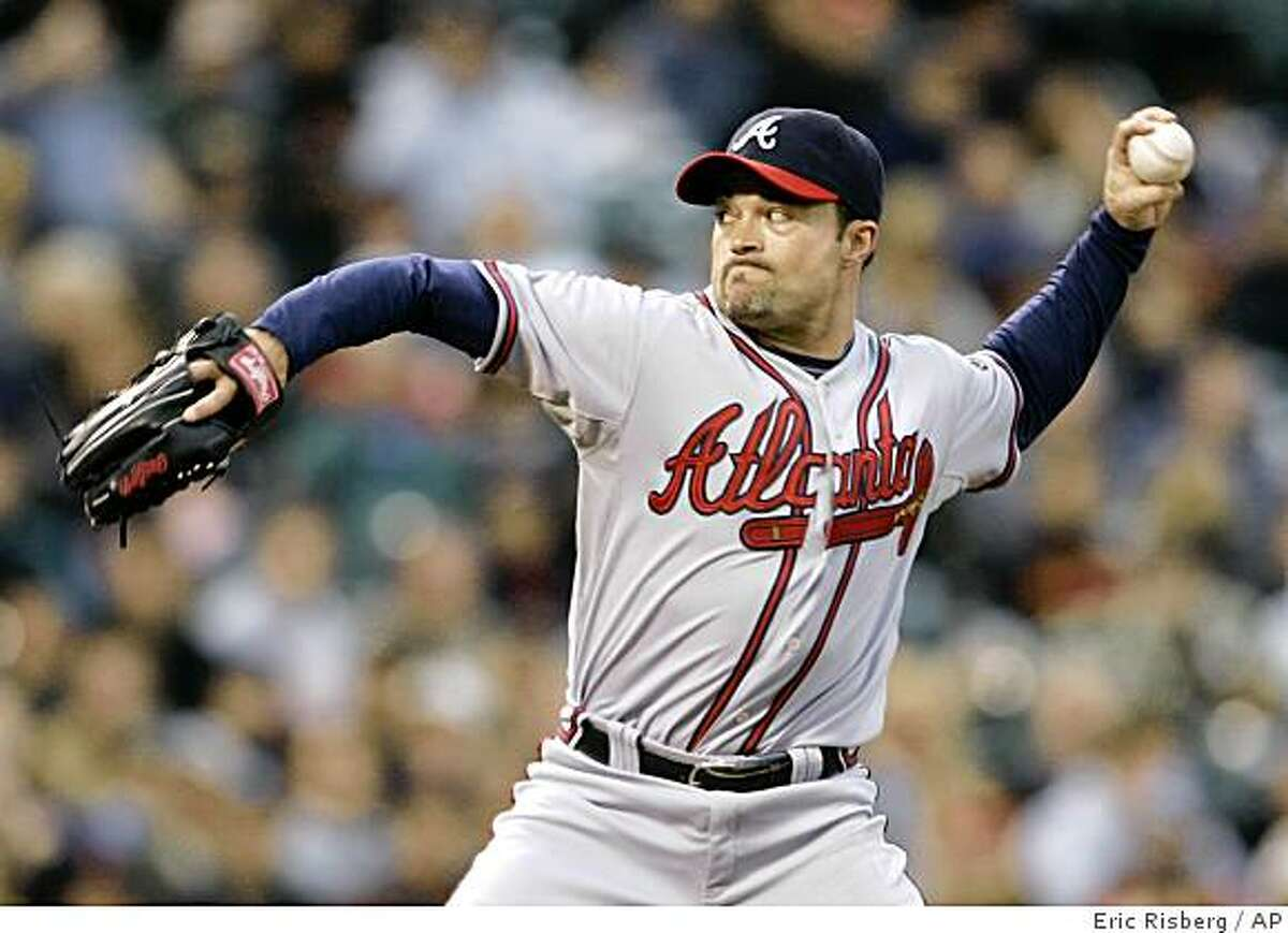 Atlanta Braves starting pitcher Mike Hampton throws against the San Francisco Giants in the first inning of a baseball game in San Francisco, Tuesday, Aug. 5, 2008. (AP Photo/Eric Risberg)