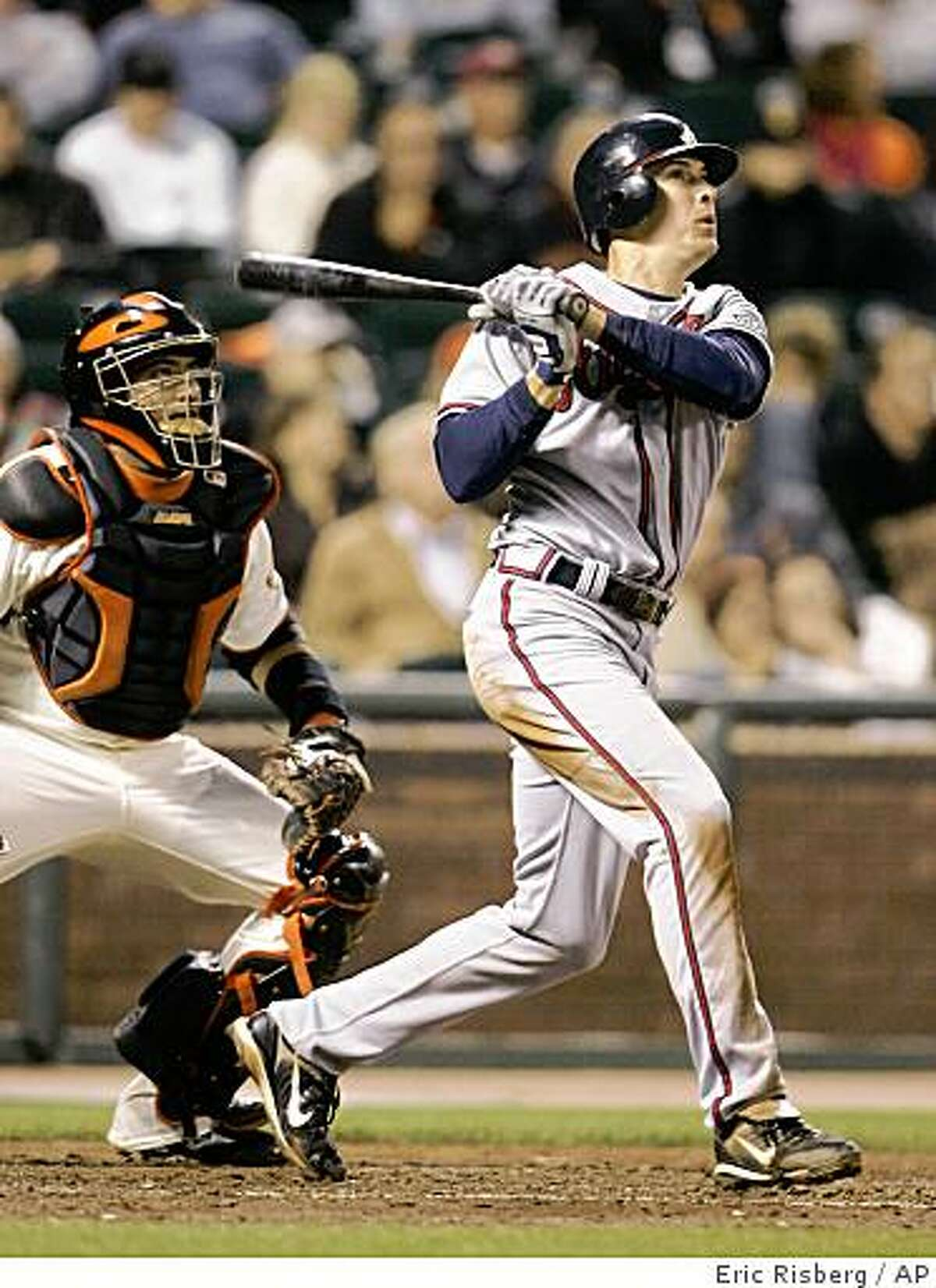 Atlanta Braves' Kelly Johnson hits a double to center field off San Francisco Giants starting pitcher Jonathan Sanchez during the fifth inning of a baseball game in San Francisco, Tuesday, Aug. 5, 2008. At left is San Francisco Giants catcher Bengie Molina. Atlanta won the game 11-4. (AP Photo/Eric Risberg)