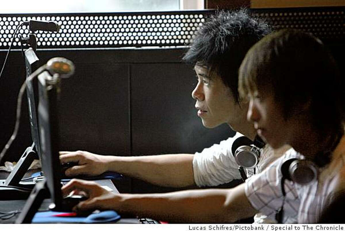 Young Chinese use computers in an Internet cafe in Shanghai, China, on September 21, 2007. Photo by Lucas Schifres / Pictobank / Special to The Chronicle