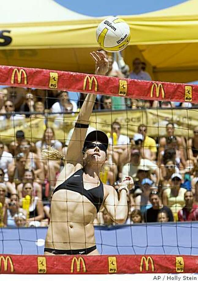 In this photo provided by the AVP, Kerri Walsh hits the ball during the women's finals at the AVP Chicago Open at the Oak Street Beach in Chicago, Sunday July 13, 2008  Walsh and her partner, Misty May-Treanor,  defeated Elaine Youngs and Nicole Branagh 18-21, 21-17, 15-12.  Both teams will represent the United States at the 2008 Olympics. (AP Photo/AVP, Holly Stein) ** NO SALES ** Photo: Holly Stein, AP