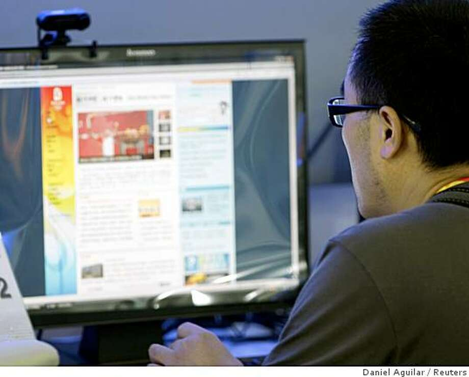 A journalist uses a computer at the Main Press Center in Beijing August 1, 2008. The International Olympic Committee and the Chinese organizers BOCOG have agreed to lift all Internet restrictions for media covering the Beijing Games, the IOC told Reuters on Friday. Reuters photo by Daniel Aguilar Photo: Daniel Aguilar, Reuters