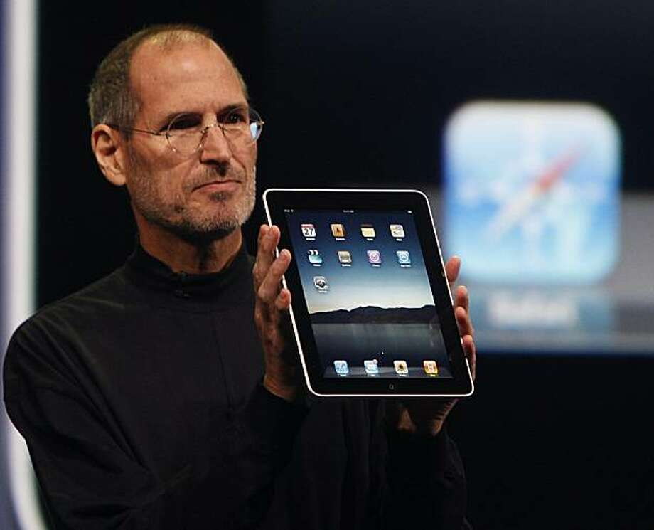 Apple CEO Steve Jobs introduces the iPad tablet to invited guests at the Yerba Buena Center for the Arts in San Francisco on Wednesday. Photo: Paul Chinn, The Chronicle