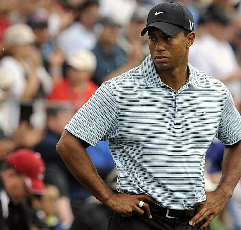 FILE -- Tiger Woods on the 17th green of the US Open Championship, June 20, 2009, in Farmingdale, N.Y. Without being specific, Woods admitted transgressions on Wednesday, Dec. 2, 2009, in a rare and personal appeal on his Web site. He apologized to his family for letting them down and appealed again for a measure of privacy amid the firestorm of coverage that has encircled him since he crashed his car outside his house early Friday morning. (Barton Silverman/The New York Times) Photo: Barton Silverman, NYT