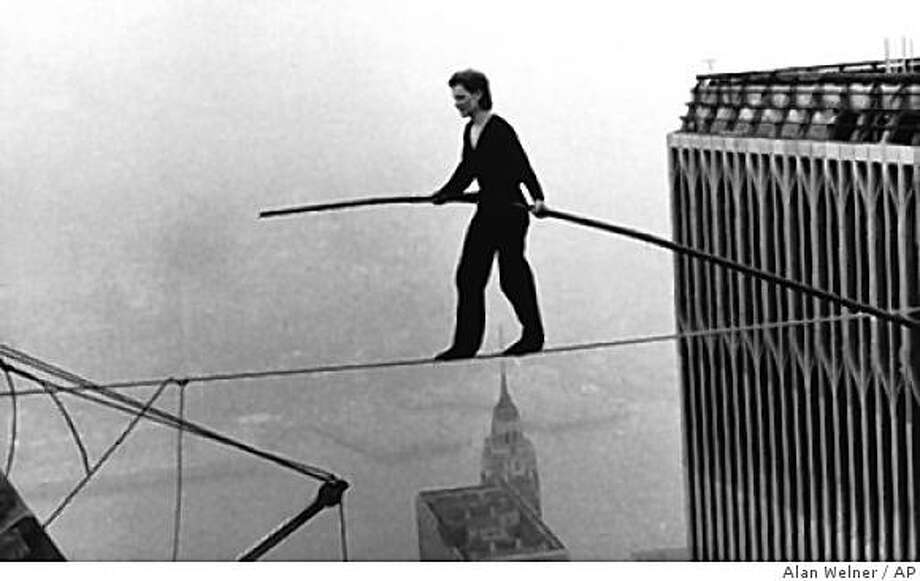 """Philippe Petit, doing  a high wire walk between the Twin Towers in 1974, is the subject of the documentary """"Man on Wire""""Philippe Petit, a French high wire artist, walks across a tightrope suspended between the World Trade Center's Twin Towers. New York, Aug. 7, 1974. (AP Photo/Alan Welner) Photo: Alan Welner, AP"""