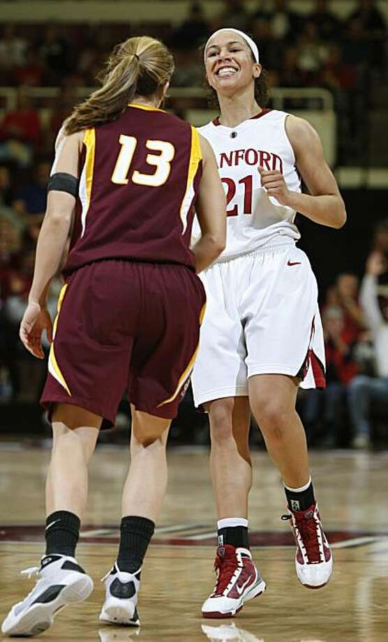Stanford guard Rosalyn Gold-Onwude (21) smiles in front of Arizona State guard Danielle Orsillo (13) after scoring a three pointer in the second half of an NCAA college basketball game in Stanford, Calif., Thursday, Jan. 28, 2010. Photo: Paul Sakuma, AP