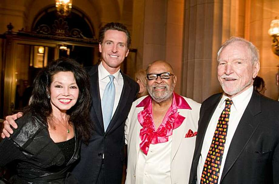 "Janice Mirikitani, Mayor Gavin Newsom, Rev. Cecil Williams and Ambassor James Hormel at Glide's annual holiday festival ""From the 'Hood to the House"" on Nov. 12 at the War Memorial Opera House in San Francisco. The evening featured music, poetry and dance in honor of Rev. Cecil Williams' 45 years at Glide. Photo: Alain McLaughlin"
