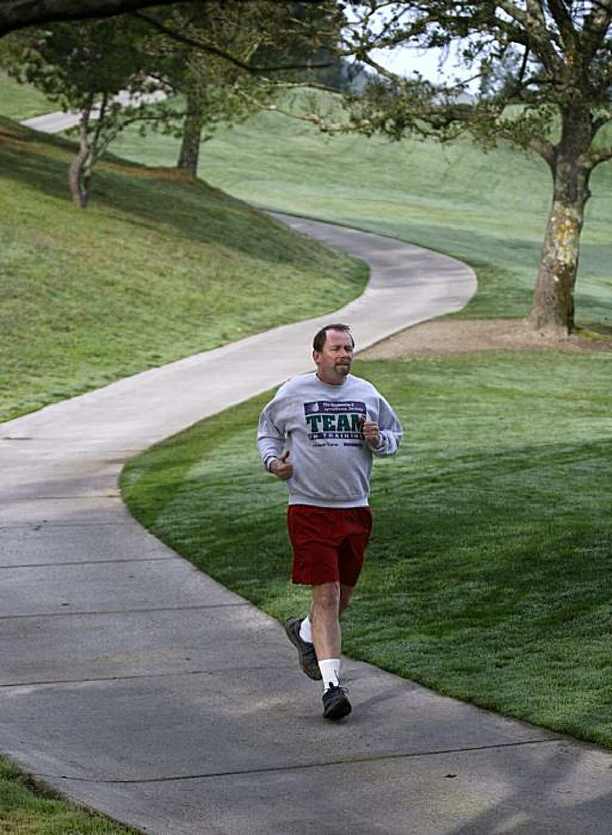 Paul Williams, a scientist at the Lawrence Berkeley National Laboratory, goes for a run near his home in Moraga, Calif., on Friday, Jan. 15, 2010. Williams has spent the past 20 years studying the science of running, using over 100,000 runners participating in his research.