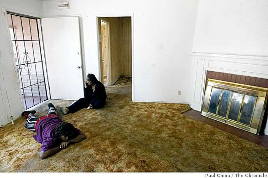 Joann Gardner and her niece Corrin Bailey, left, waits at the front door of her empty home before handing over the keys to representatives of a real estate company in Oakland, Calif., on Saturday, Aug. 2, 2008. Gardner and her parents Johnnie and Estelle were evicted from their home of 51 years after the lender foreclosed on the property. Photo: Paul Chinn, The Chronicle