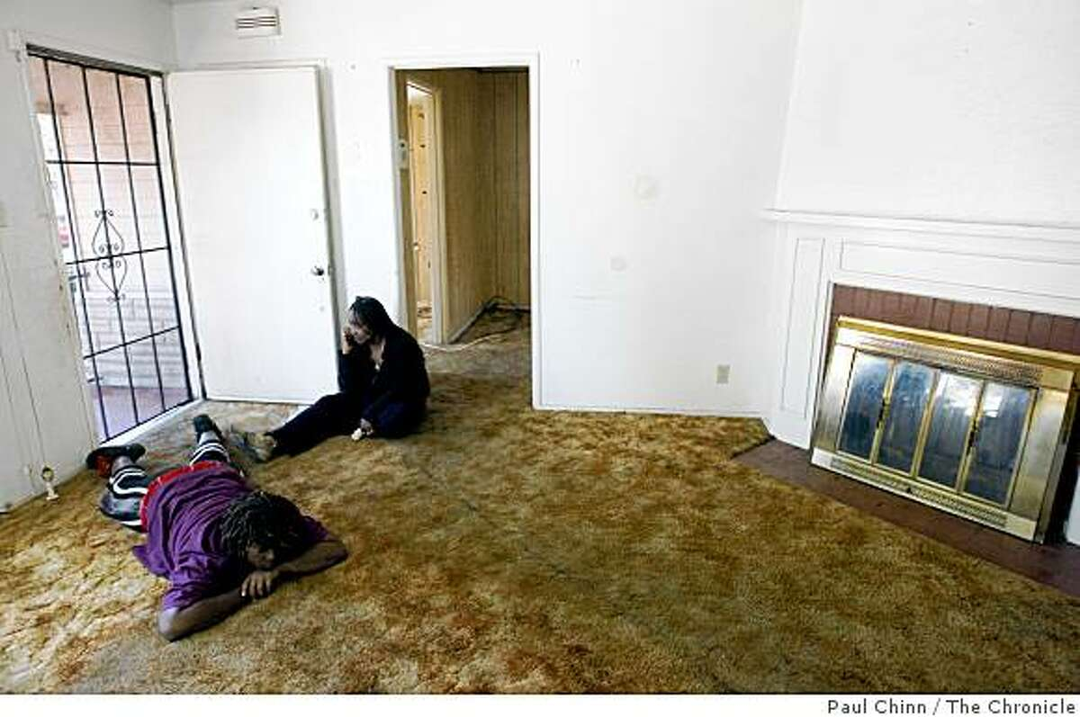 Joann Gardner and her niece Corrin Bailey, left, waits at the front door of her empty home before handing over the keys to representatives of a real estate company in Oakland, Calif., on Saturday, Aug. 2, 2008. Gardner and her parents Johnnie and Estelle were evicted from their home of 51 years after the lender foreclosed on the property.