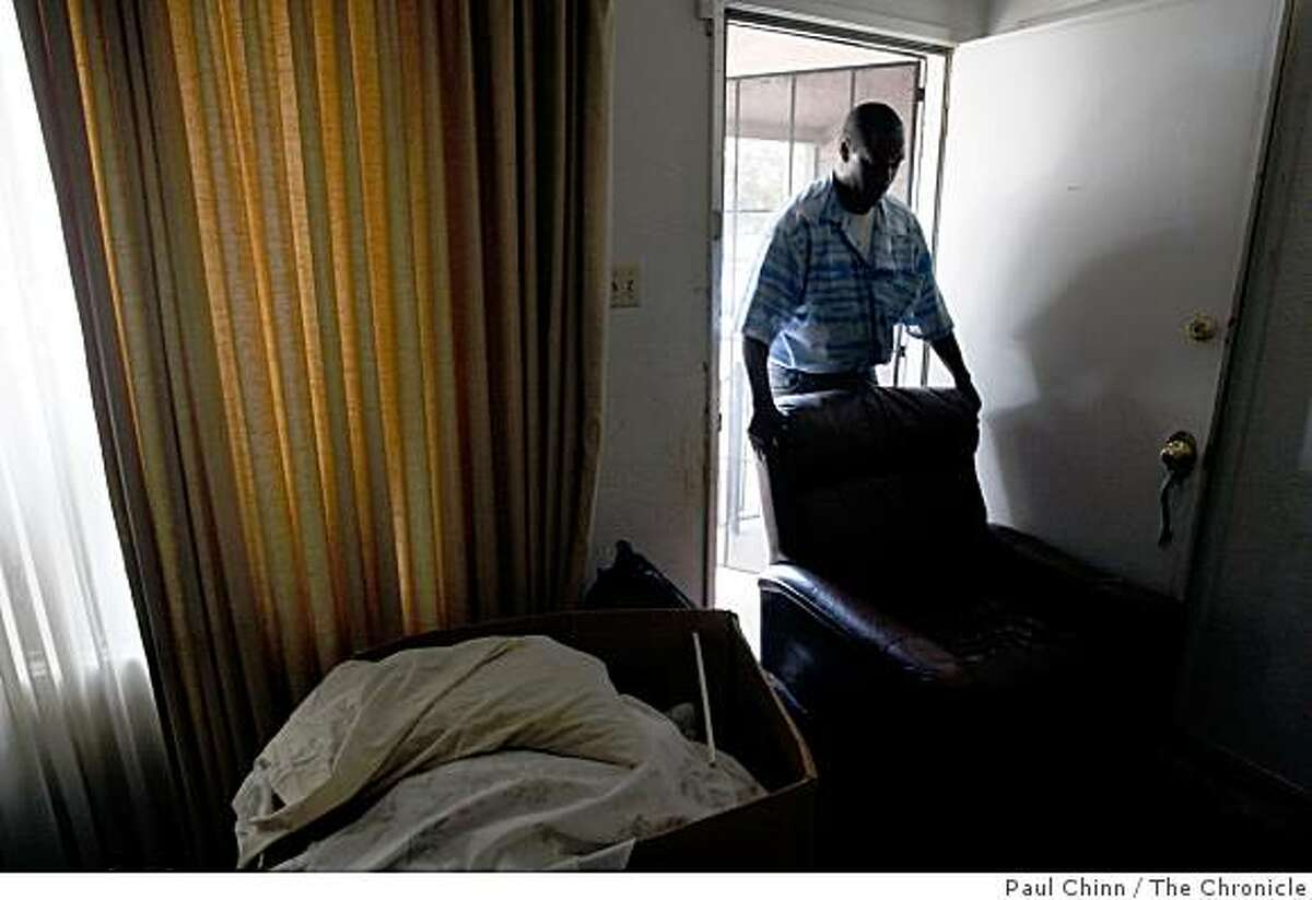 A worker from The Salvation Army removes a recliner from Joann Gardner's home in Oakland, Calif., on Monday, July 28, 2008. Gardner and her parents were evicted from their home of 51 years after the lender foreclosed on the property.Photo by Paul Chinn / The Chronicle