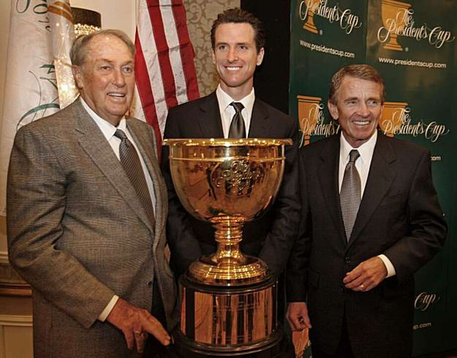 Howard Lester, The Presidents Cup, General Chairman, Gavin Newsom, SF Mayor and Tim Finchem, PGA Tour, Commissioner (L-R) pose in front of the President Cup trophy at the Fairmont, SF. Photo: Frederic Larson, The Chronicle