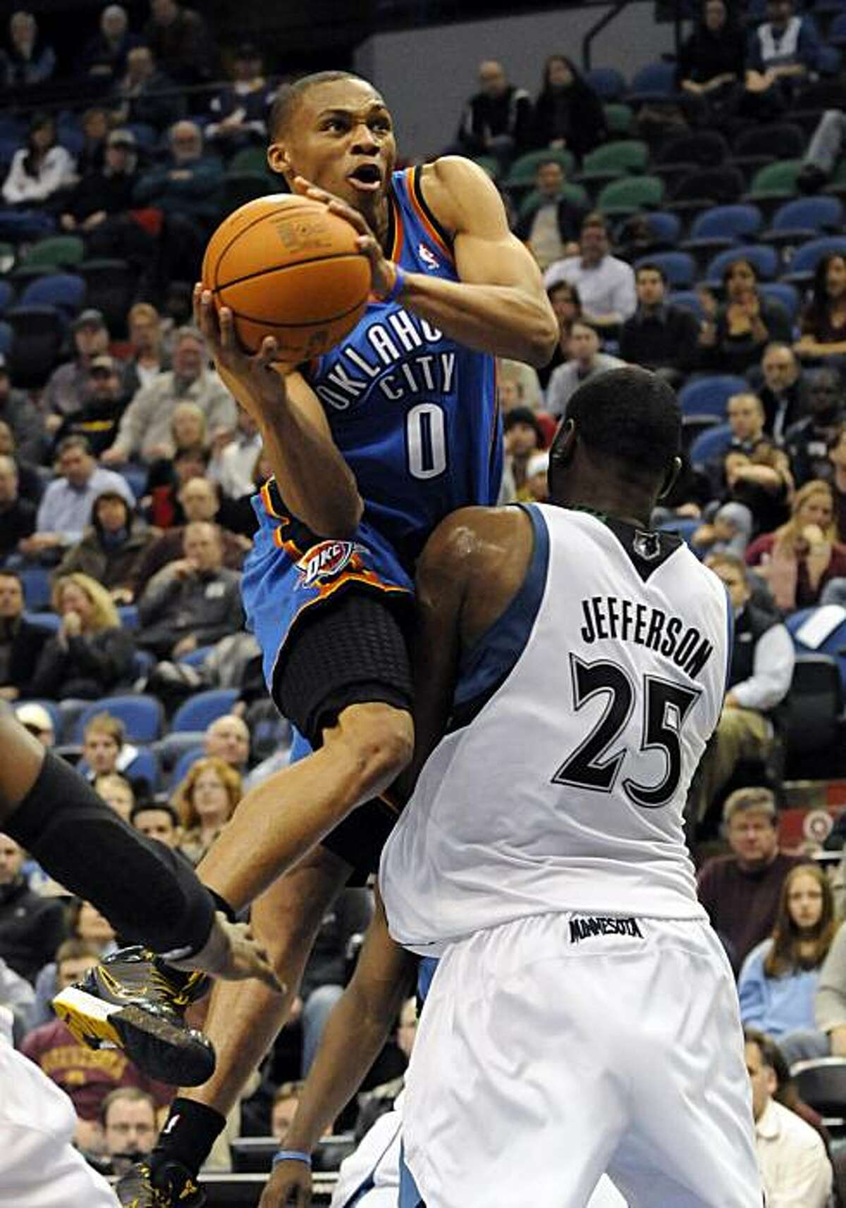 Oklahoma City Thunder's Russell Westbrook (0) attempts a shot against the defense of the Minnesota Timberwolves in the second half of an NBA basketball game Wednesday, Jan. 20, 2010 in Minneapolis. The Thunder won 94-92.