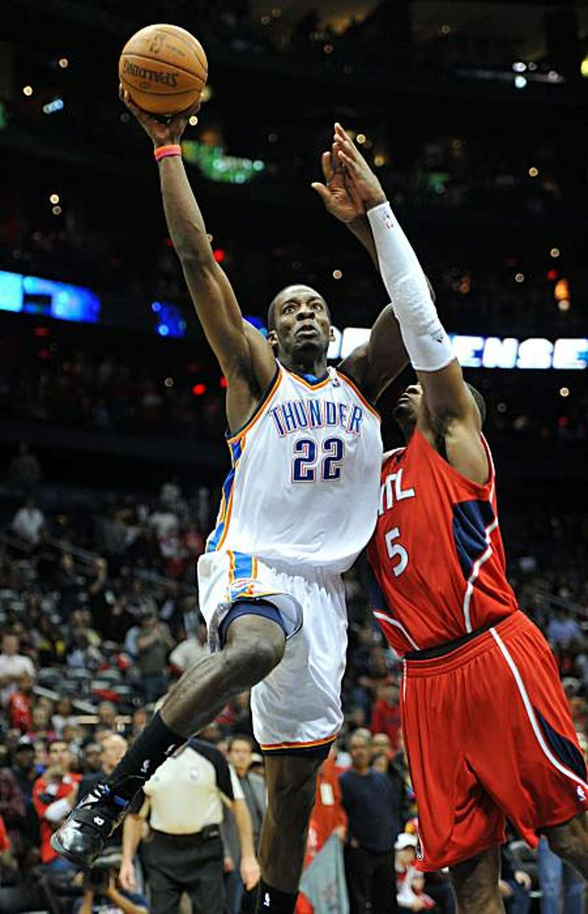 Oklahoma City Thunder's Jeff Green (22) goes to the basket against Atlanta Hawks' Josh Smith (5) with just under 15 seconds left in the game to score in the fourth quarter of an NBA basketball game in Atlanta, Monday, Jan. 18, 2010. The Thunder won 94-91.