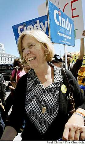 Anti-war activist Cindy Sheehan wades through a protest by about a dozen MInutemen supporters and 200 counter-demonstrators at City Hall in San Francisco, Calif., on Wednesday, July 30, 2008. The Minutemen were calling on Mayor Gavin Newsom to resign because of his position on sanctuary for immigrants. Sheehan was at City Hall to hand in signatures to get on the November ballot for her candidacy for Congress.Photo by Paul Chinn / The Chronicle Photo: Paul Chinn, The Chronicle