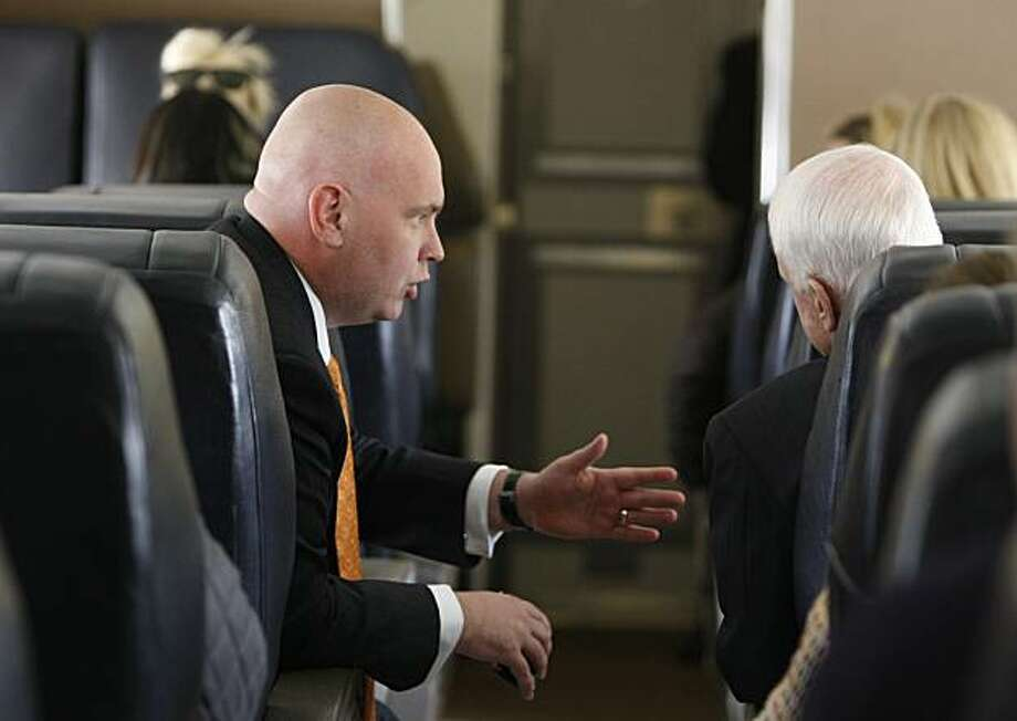 Sen. John McCain, R-Ariz., right, talks with senior adviser Steve Schmidt, left, after arriving  in Romulus, Mich., Feb. 21. Photo: Gerald Herbert, AP