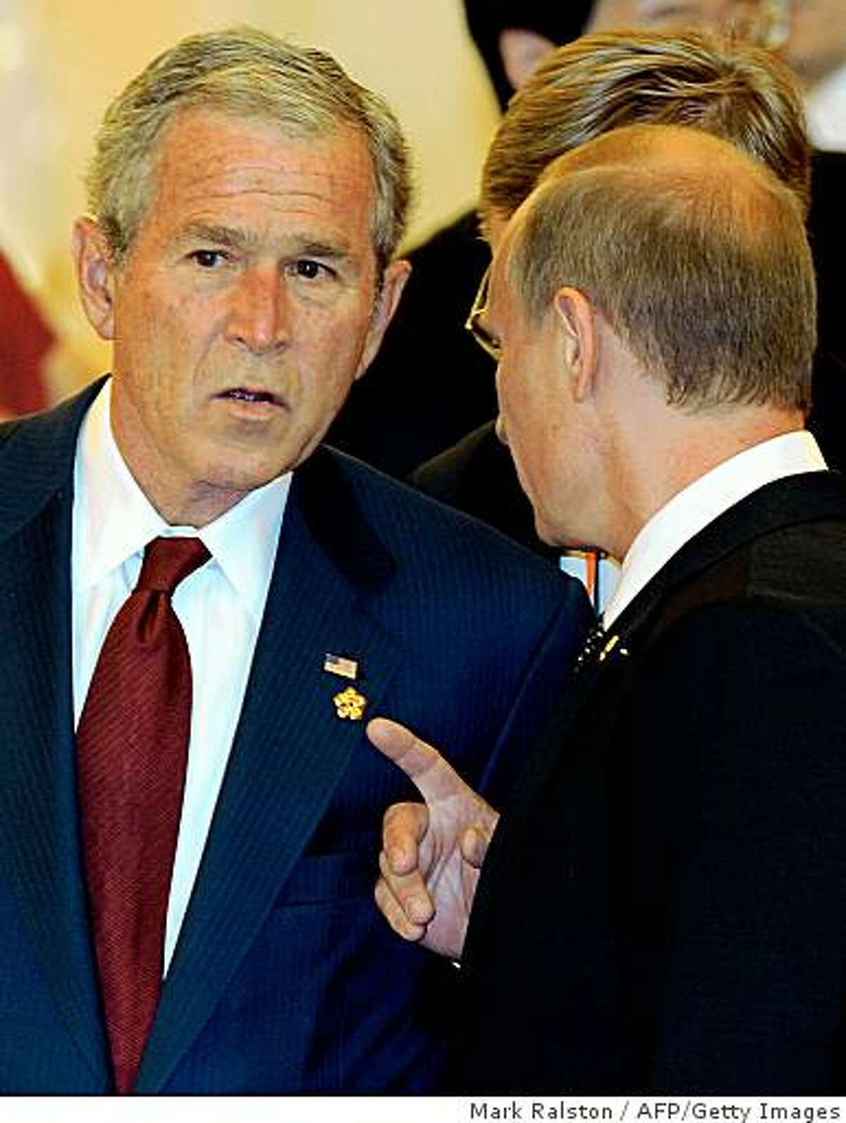 US President George W. Bush (L) talks with Russian Prime Minister Vladimir Putin (R) before a banquet for heads of state in the Great Hall of the People in Beijing on August 8, 2008. President Bush made a new plea for freedom of expression in China just hours before the opening ceremony of the Olympic Games. The US leader, who has said he does not want to politicise his attendance at the Games, said he could be candid with China because the two countries had built up a strong relationship built on