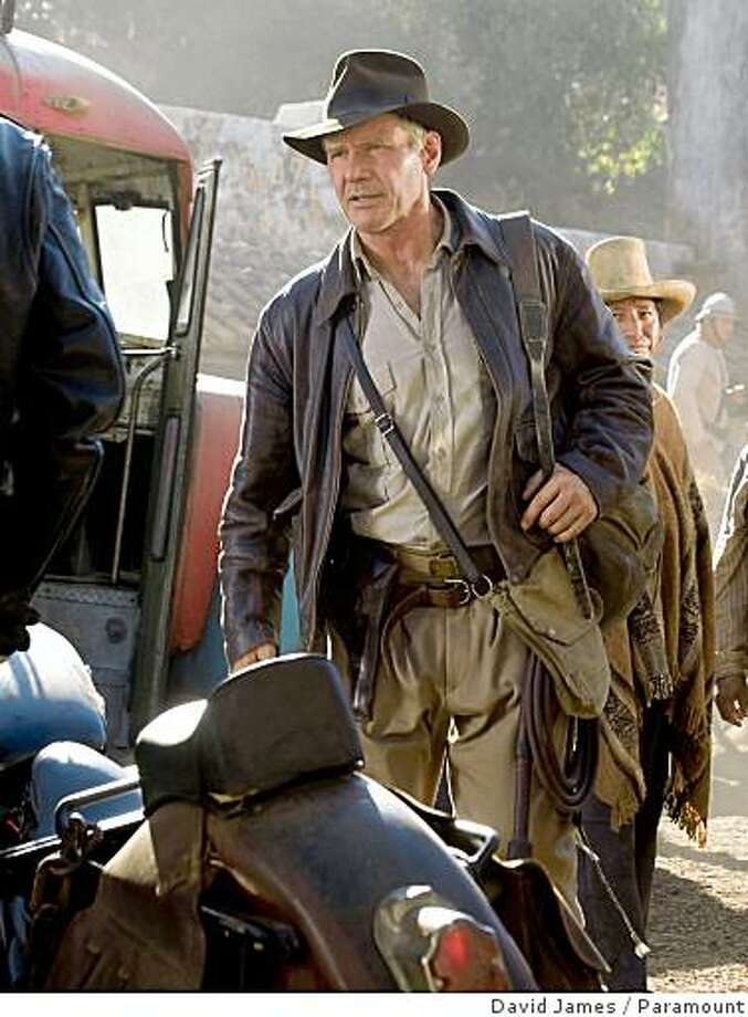 "**FILE** This file photo released by Paramount Pictures shows actor Harrison Ford as Indiana Jones in a scene from ""Indiana Jones and the Kingdom of the Crystal Skull,"" due out May 22, 2008.   Though he preaches research and good science in the classroom, the world's most famous archaeologist often is an acquisitive tomb raider in the field with a scorched-earth policy about what he leaves behind. While actual archaeologists like the guy and his movies, they wouldn't necessarily want to work alongside him on a dig.     (AP Photo/Paramount Pictures, David James, FILE) ** NO SALES ** Photo: David James, Paramount"