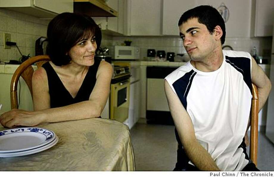 Asmik Karapetian and her son Arthur chat before lunch at home in Fresno, Calif., on Thursday, June 26, 2008. The Armenian family immigrated to the United States about 16 years ago and may be deported by Immigrations and Customs Enforcement if a bill introduced by Sen. Dianne Feinstein fails to pass.Photo by Paul Chinn / The Chronicle Photo: Paul Chinn, The Chronicle