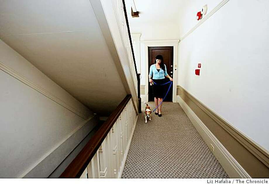 Traci Hinden is a dog-owner who rents an apartment in San Francisco, Calif., with her 15-pound pug-Jack Russell terrier mix named Bowie as they leave the apartment to take a walk on Wednesday, July 23, 2008. Photo by Liz Hafalia/The Chronicle Photo: Liz Hafalia, The Chronicle