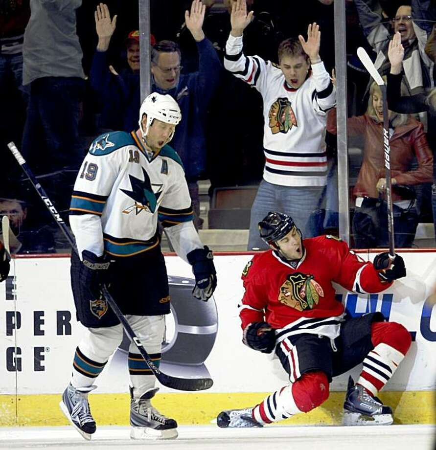 Chicago Blackhawks' Brent Seabrook celebrates while he skates past San Jose Sharks' Joe Thornton after scoring the winning goal in overtime during an NHL hockey game in Chicago on Sunday, Nov. 15, 2009. Blackhawks won 4-3. (AP Photo/Charles Cherney) Photo: Charles Cherney, AP