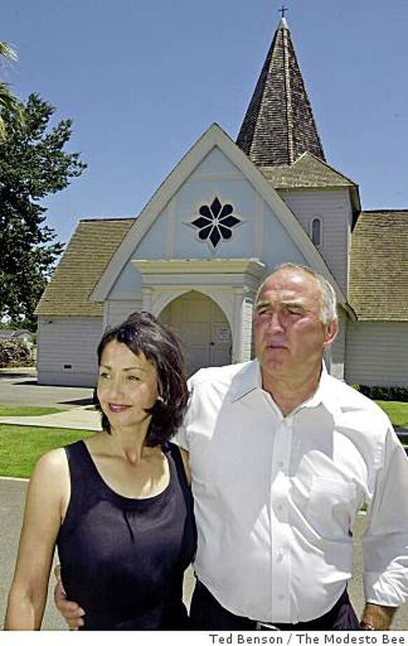 Vicki and Doug Porter are shown outside the Hickman Community Church, where Porter is the minister. The Porters are in the process of building a community museum behind the church at the request of the late Frank Craig, who donated $1.5 million to the project.  Photographed on Saturday  6/12/04.      Ted Benson/The Modesto Bee Photo: Ted Benson, The Modesto Bee