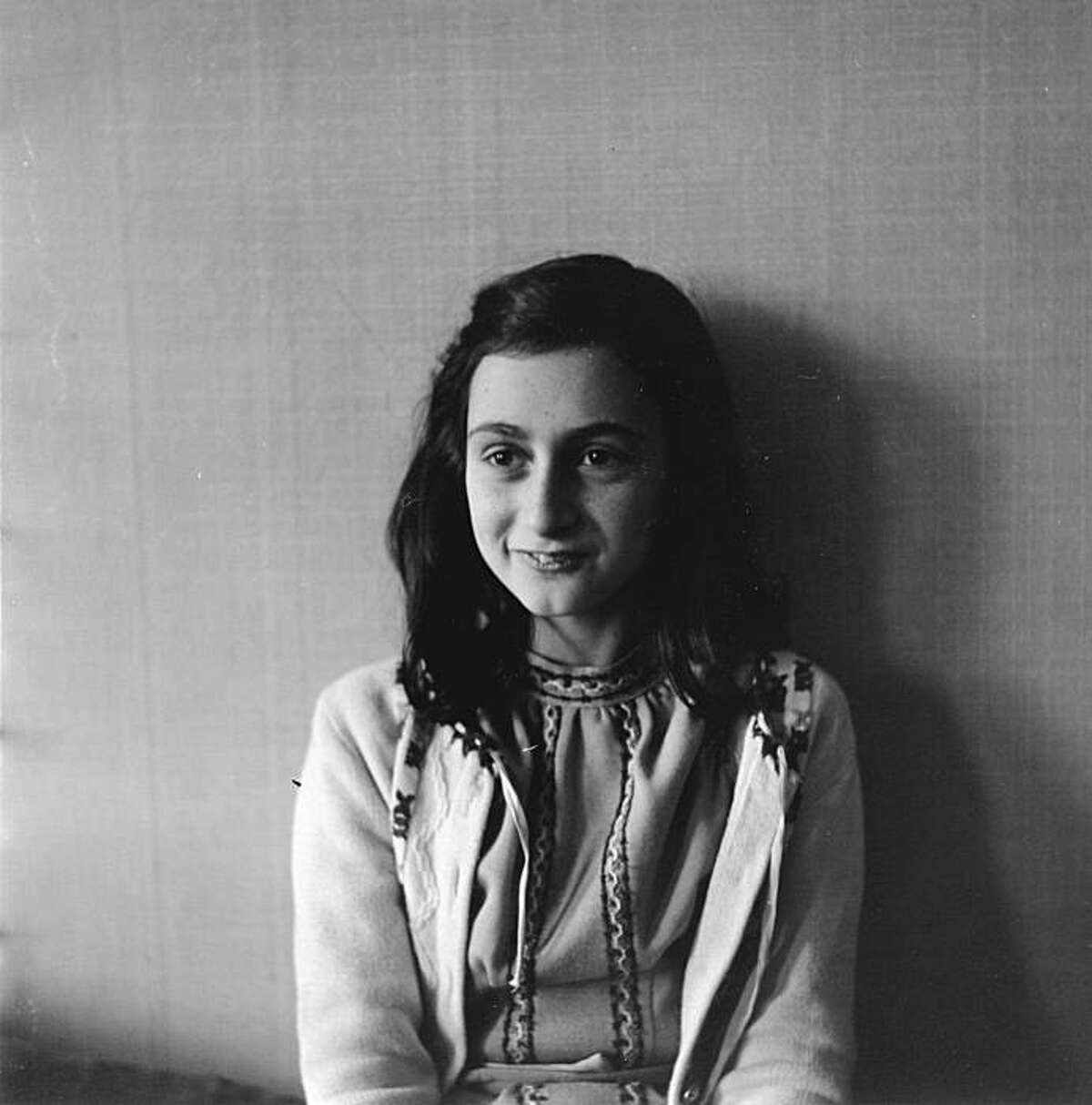 Anne Frank poses in 1941 in this photo made available by Anne Frank House in Amsterdam, Netherlands, Thursday, June 11, 2009. The Anne Frank House museum says it will permanently exhibit her diaries and other writings as part of activities commemorating the 80th anniversary of her birth on June 12, 1929. Frank died aged 15 in a concentration camp, but her posthumously published diary has made her a symbol of all Jews killed in World War II. (AP Photo/ Anne Frank House/ Frans Dupont, HO) ** ONE TIME USE ONLY ** NO SALES **