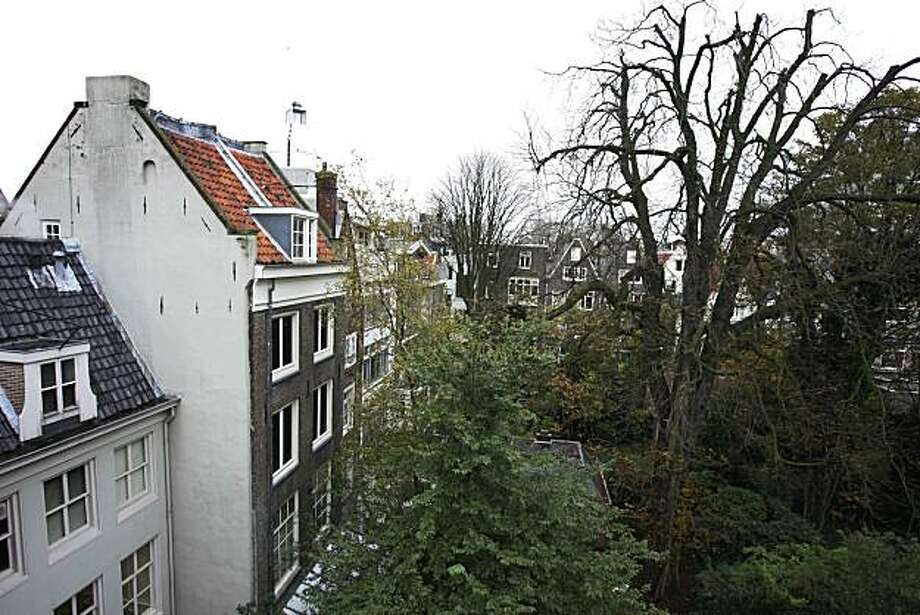 This Nov. 15, 2006 photo shows the diseased chestnut tree, right, that comforted Anne Frank while she hid from the Nazis during World War II, which has now been granted a reprieve. Photo: Peter DeJong, AP