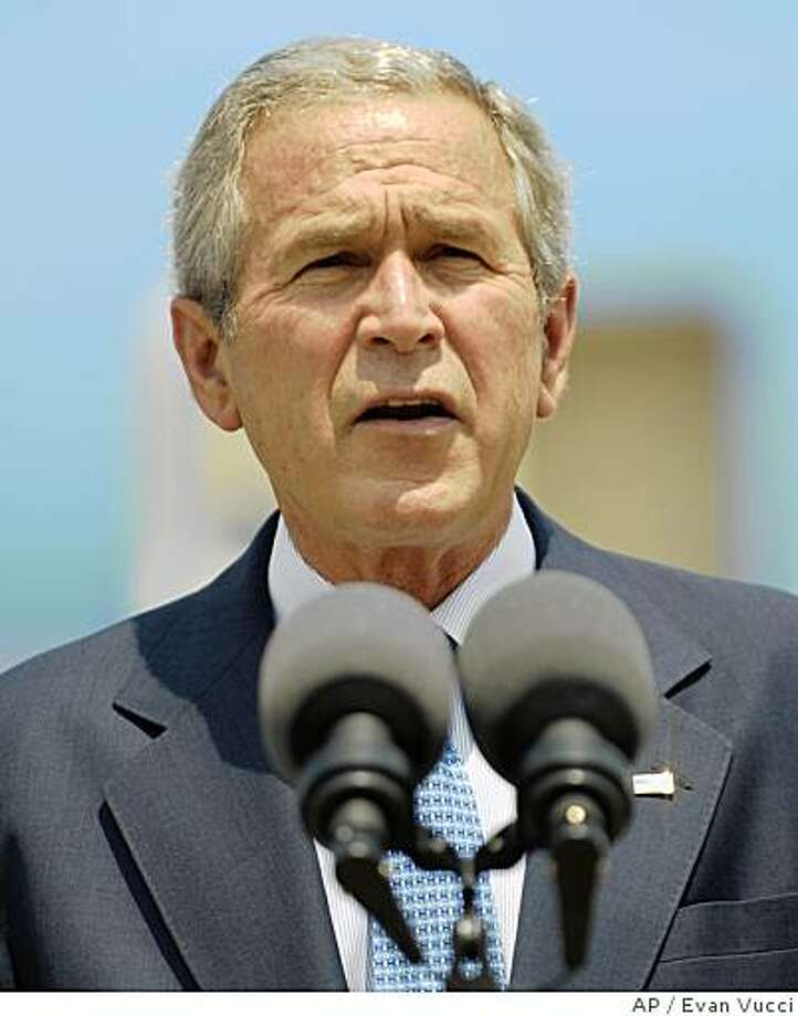 President Bush pauses as he speaks with reporters after arriving at Ellington Field Friday, July 18, 2008 in Houston.  (AP Photo/Evan Vucci) Photo: Evan Vucci, AP