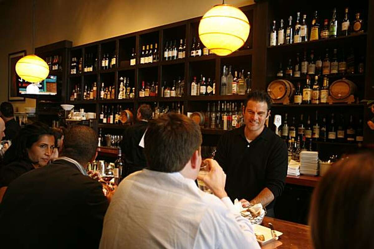 Richard Wood, owner of Wood Tavern restaurant, behind the bar talking with friend, Michael Brown in Oakland, Calif., on June 16, 2008 Photo by Craig Lee / The Chronicle