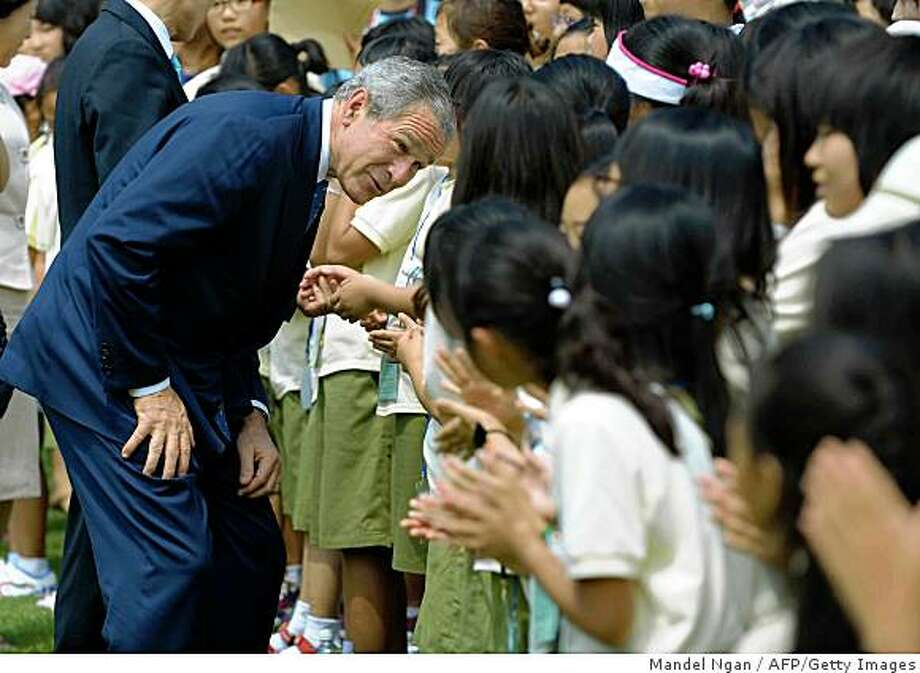 US President George W. Bush greetS children after lunch at the presidential Blue House in Seoul on August 6, 2008. US President George W Bush is in South Korea on the first leg of his Asian tour. AFP PHOTO/Mandel NGAN (Photo credit should read MANDEL NGAN/AFP/Getty Images) Photo: Mandel Ngan, AFP/Getty Images