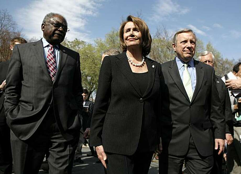 House Speaker Nancy Pelosi is flanked by Rep. James Clyburn (left) and Sen. Dick Durbin as they leave a news conference. Photo: Kevin Lamarque, Reuters