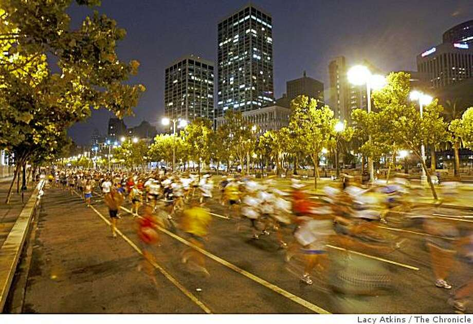 Thousands of runners takeoff before dawn as they run down the Embarcadero in the San Francisco Marathon, Sunday Aug. 3, 2008, in  San Francisco, Calif. Photo by Lacy Atkins /The Chronicle Photo: Lacy Atkins, The Chronicle