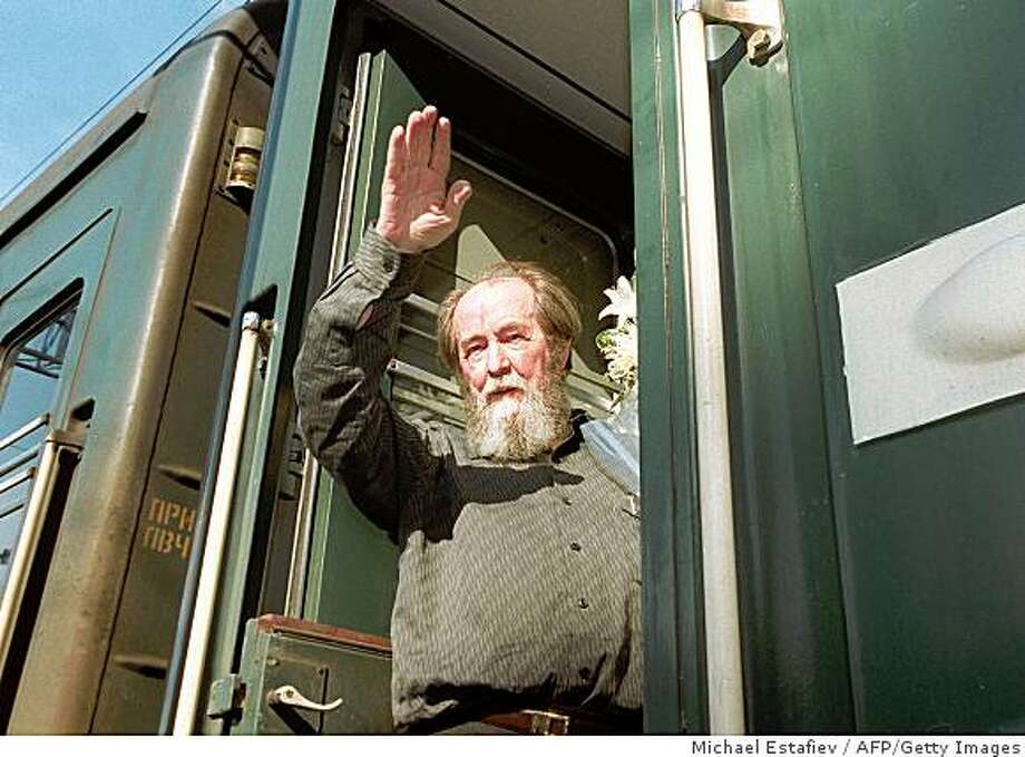 (FILES) Russian writer Alexander Solzhenitsyn waves as he gets on a train 01 June 1994 in Vladivostok bound for Khabarovsk. Russian writer and dissident Alexander Solzhenitsyn died overnight Sunday to Monday, the Itar-Tass news agency said, citing his son Stepan on August 3, 2008. He was 89. Solzhenitsyn won the Nobel Prize for literature in 1970 after writing harrowing works about the Soviet Union's system of labour camps. He was expelled from the Soviet Union in 1974. Since his return to Russia in 1994 he has been critical of the West and of Russia's post-Soviet evolution, calling for a return to traditional moral values. AFP PHOTO / MICHAEL ESTAFIEV (Photo credit should read MICHAEL ESTAFIEV/AFP/Getty Images) Photo: Michael Estafiev, AFP/Getty Images