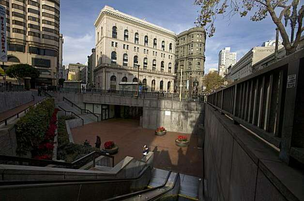 Hallidie Plaza, the sunken plaza leading into the Powell BART/Muni Station, is slated for a revamp starting with the little-used western portion close to Cyril Magnin Street. Photo: Adam Lau, The Chronicle